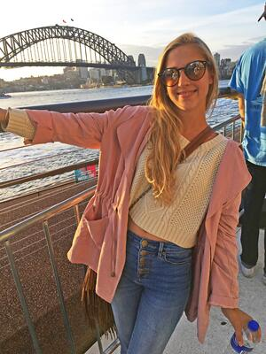 Sydney Fashion Business intern Abbey in front of the harbour
