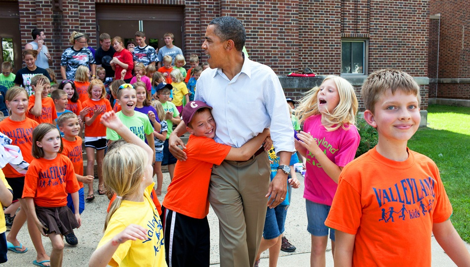 Barack Obama helping out community children