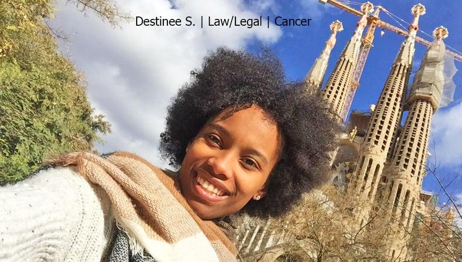 Barcelona intern smiling in front of the Sagrada Familia