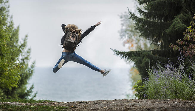 Girl jumping in the middle of nowhere