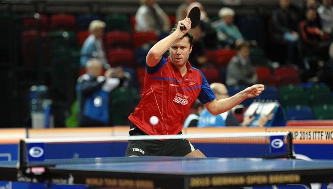 ping pong player strikes
