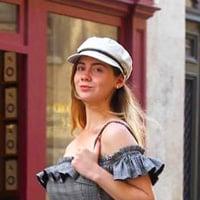 Kristen M. walking through the streets of Paris