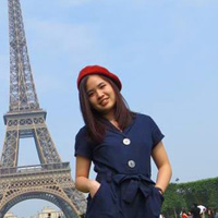 Jenny L. in front of the Eiffel Tower