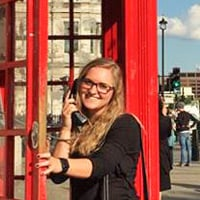 Kayla in a London phone booth