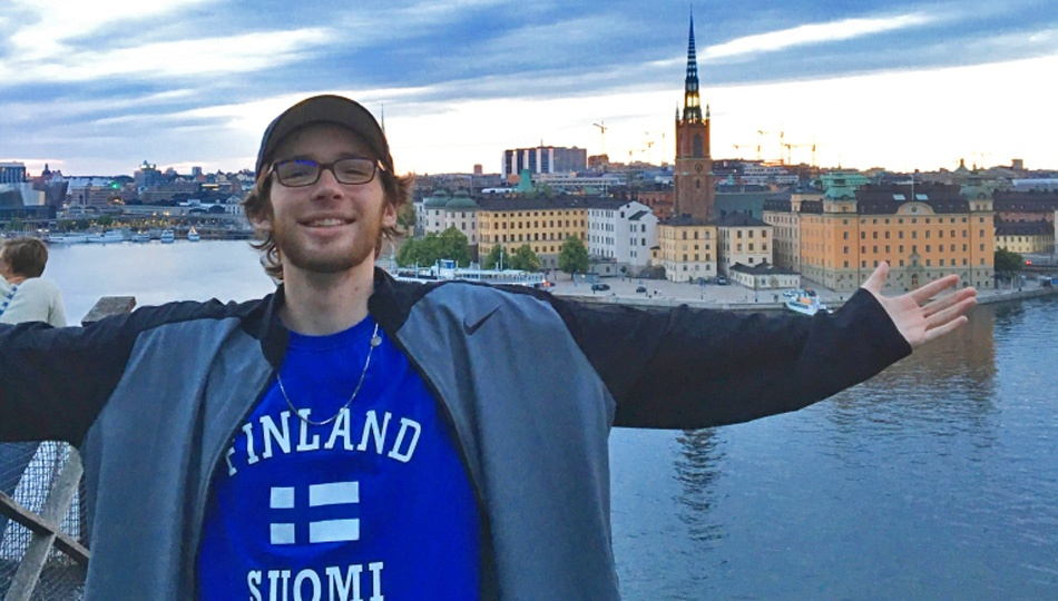 Stockholm Journalism intern Connor in front of the city skyline