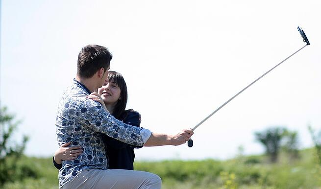 Couple taking picture with selfie stick