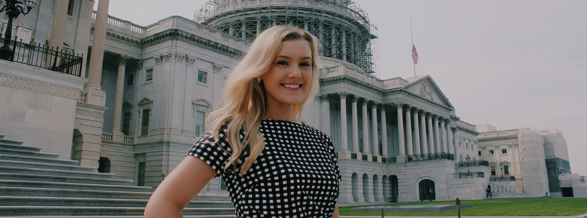 Intern standing in front of the US Capitol building