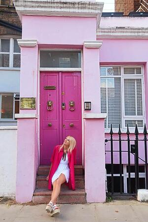 London Marketing Intern Elsie in front of a pink house