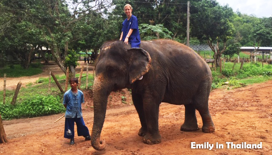 Emily riding an elephant in Thailand