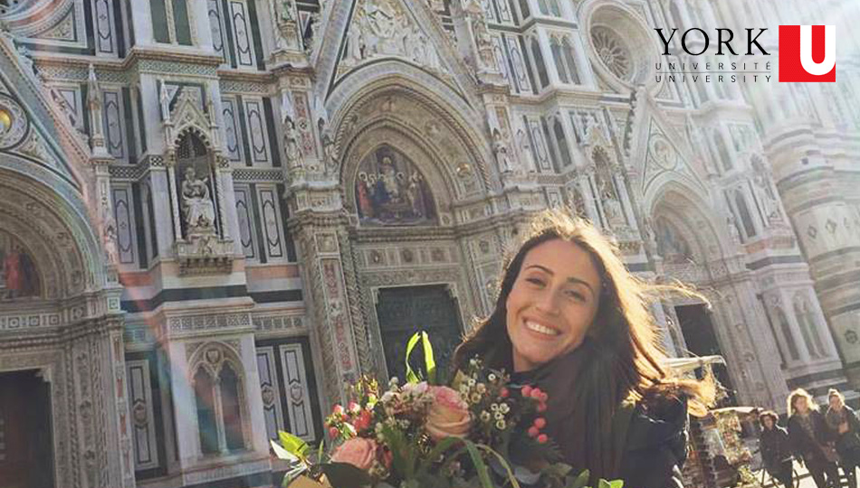 Florence Intern from York University posing in front of the Duomo