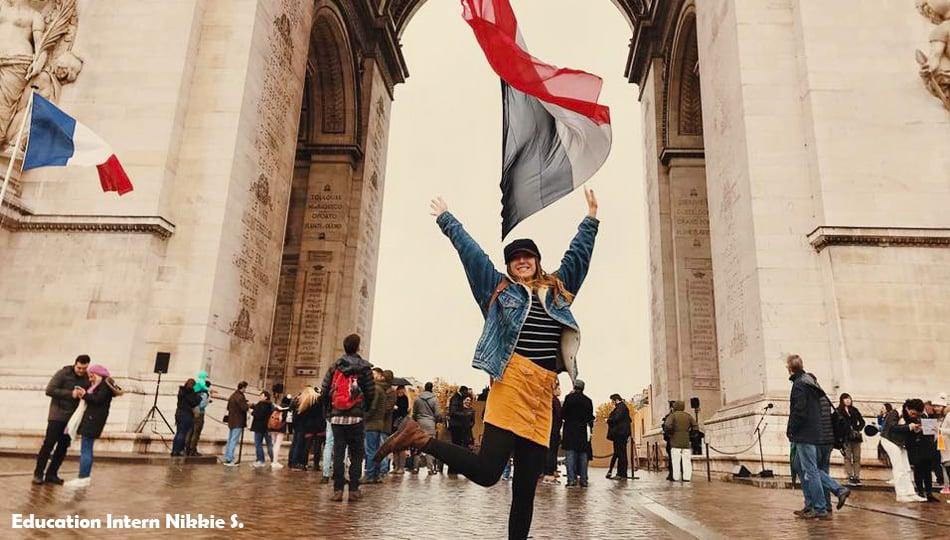 Girl jumping for joy in Paris