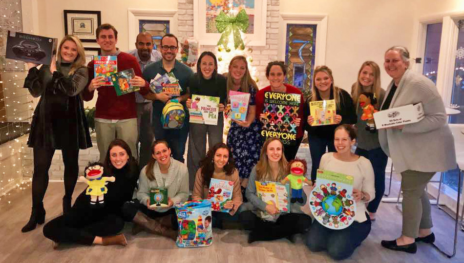 Global Experiences staff with donated-toys