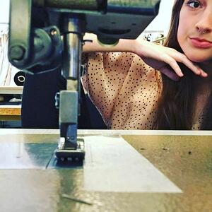 Milan Fashion intern Kelsey with a sewing machine