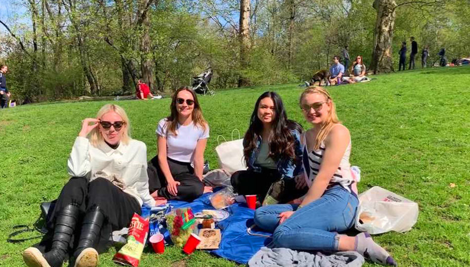 Lindsey having a picnic with friends in New York
