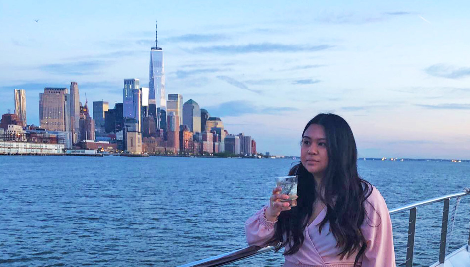 Lindsey on a boat overlooking the New York City skyline