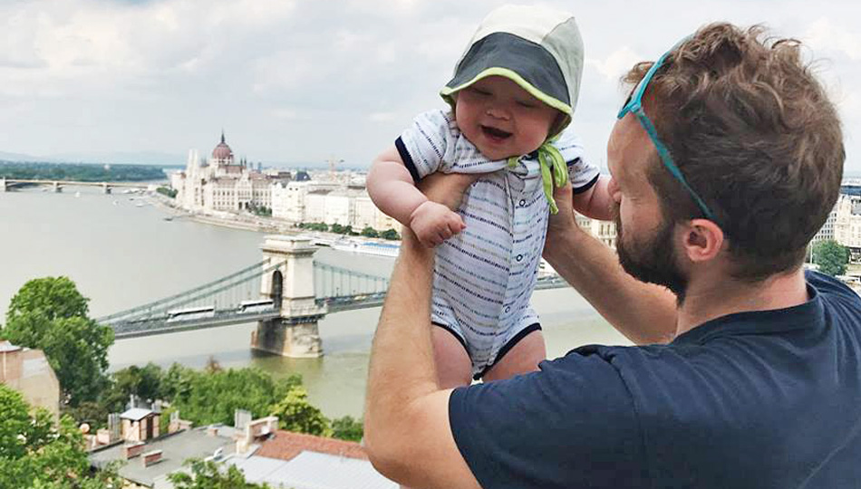 Man and his baby on a bridge