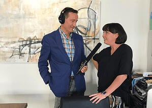 Man interviewing woman for podcast