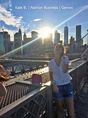 New York City intern laughing on the Brooklyn Bridge