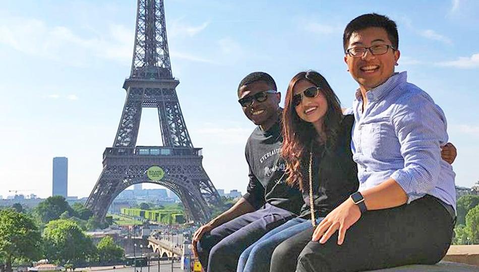 Paris interns by Eiffel Tower