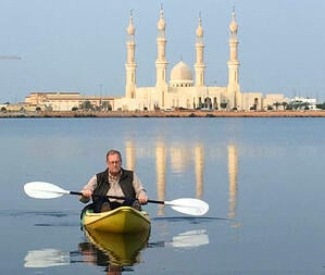 Man on a kayak in front of castle
