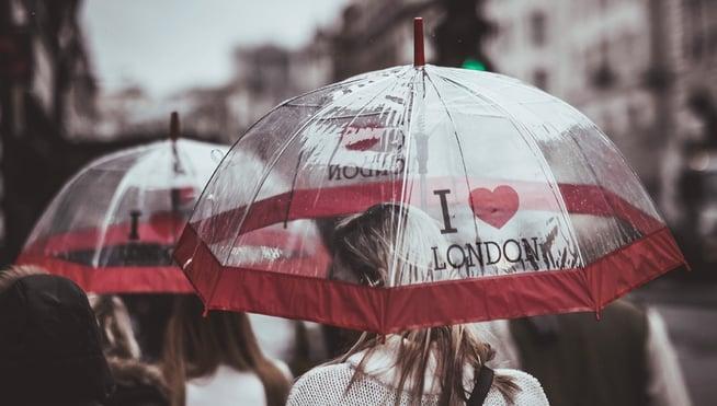 People walking in the rain with umbrellas