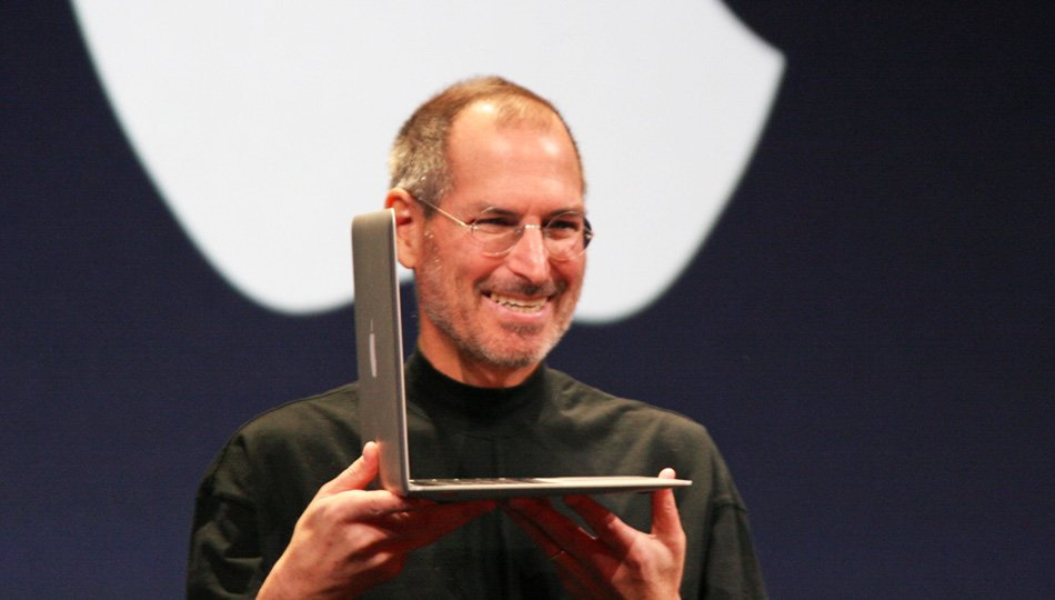 Steve Jobs presenting mac laptop