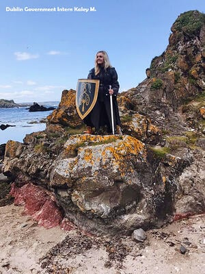 Woman Standing on a rock in Ballintoy Harbour