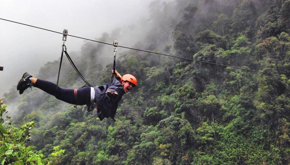 Woman-ziplining-through-the-Amazon-rainforest