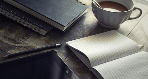 Coffee and notebooks, everything you need for a journalism internship