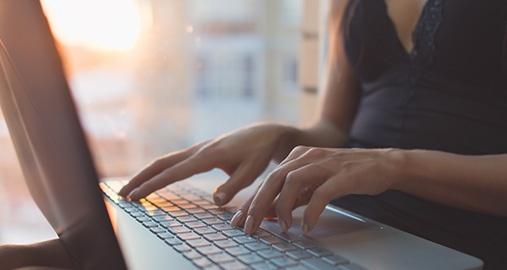 Typing away at a laptop
