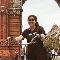 Nicole G. riding a bike through Barcelona
