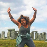 Mariah R. jumping in front of Stonehenge