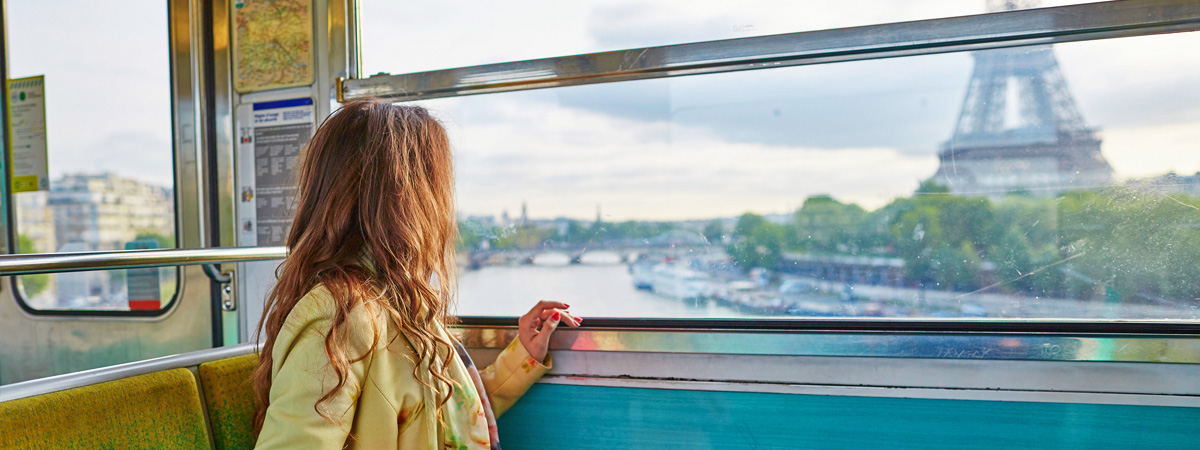 Girl-looking-at-Eiffel-Tower-from-Train
