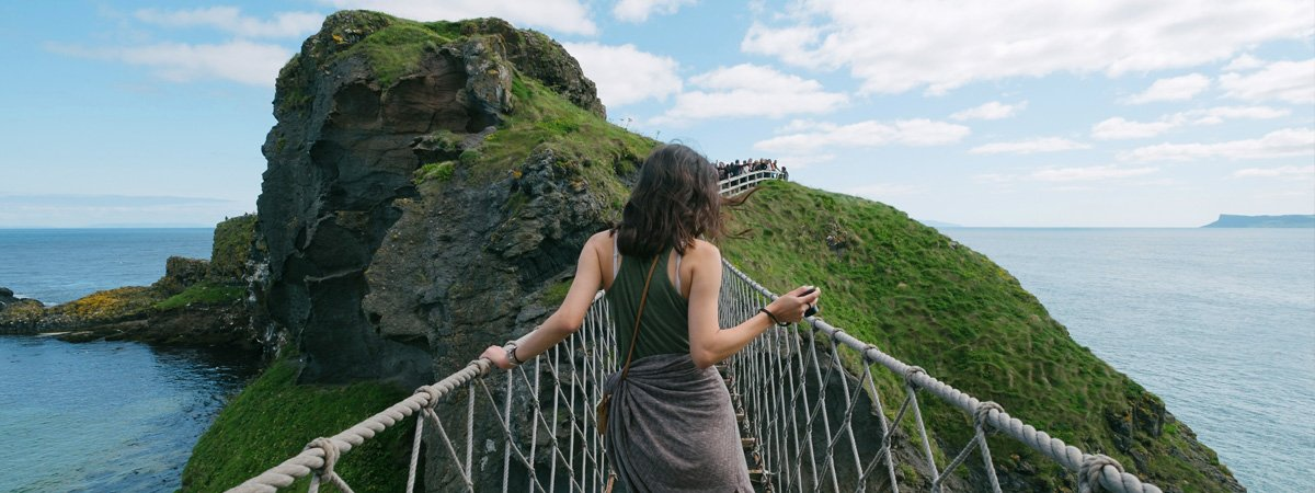 Woman-Walking-Across-the-Carrick-a-Rope-Bridge